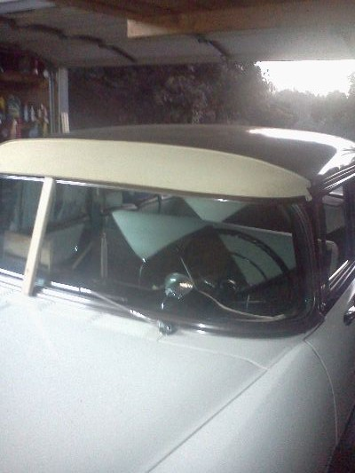 The stick in the center is the brace that has to be made and then used when your  mounting the visor to the roof. 388053164a32